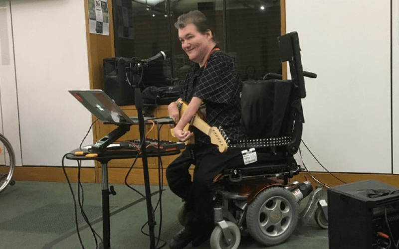 John Kelly with an adapted guitar