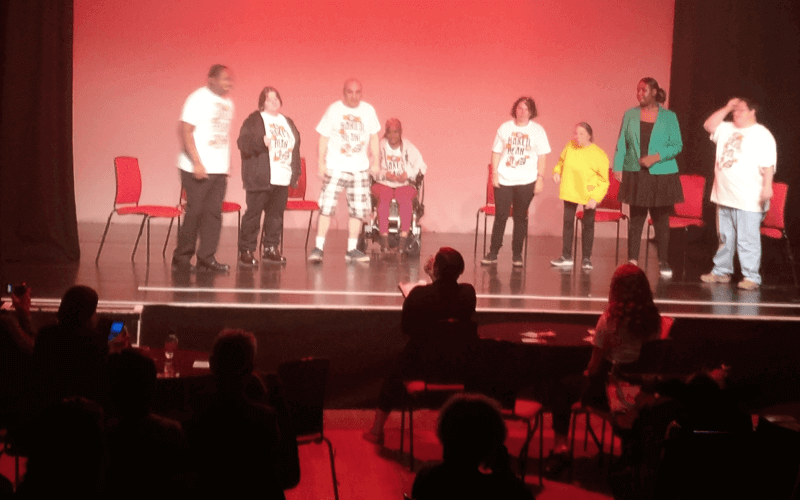 Eight people on a stage