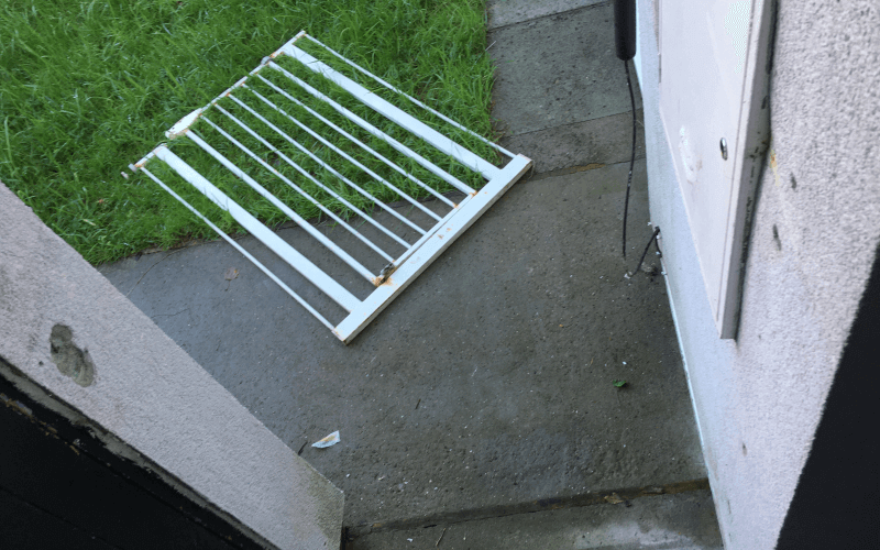 A metal gate lying on the ground