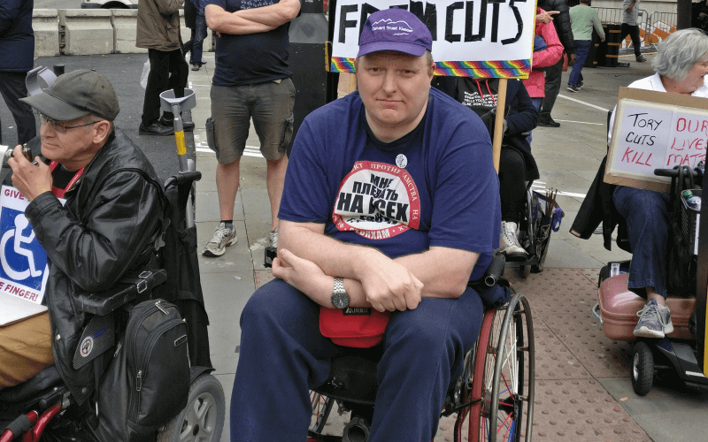 Doug Paulley, in his wheelchair, surrounded by people