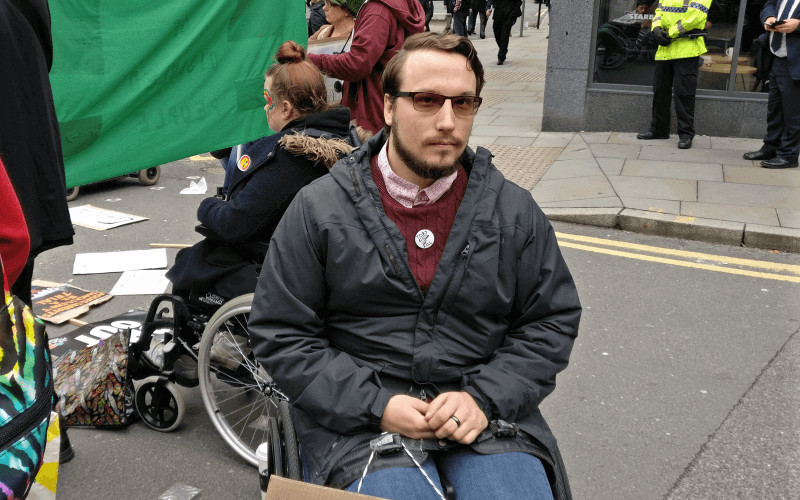 Piers Wilkinson in a wheelchair