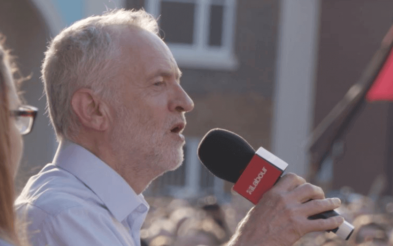 Jeremy Corbyn with a microphone