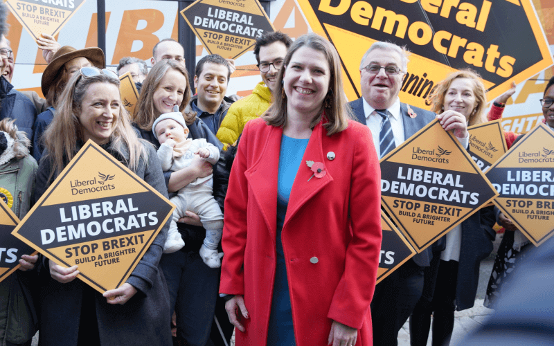 Jo Swinson in front of Lib Dem supporters