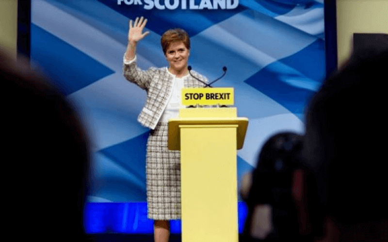 Nicola Sturgeon behind a podium