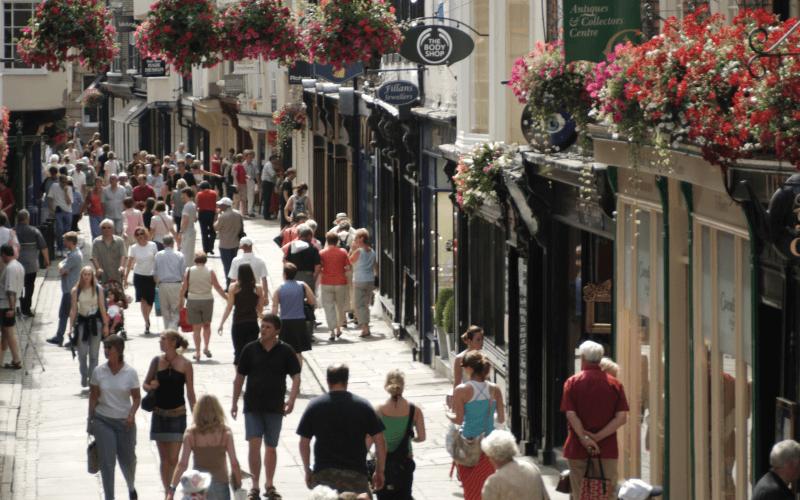 A busy pedestrian street in summer