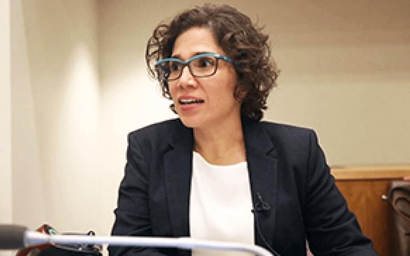 Catalina Devandas Aguilar head and shoulders