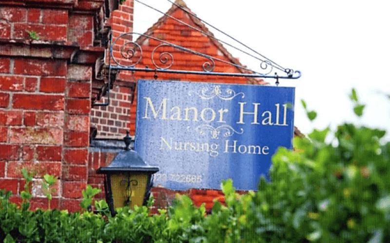 A sign for Manor Hall nursing home