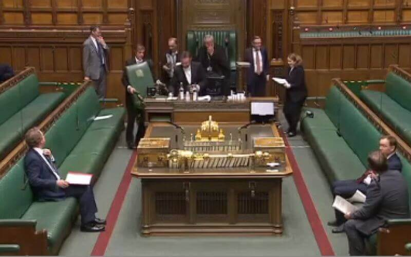 The Speaker surrounded by Commons staff in the Commons chamber
