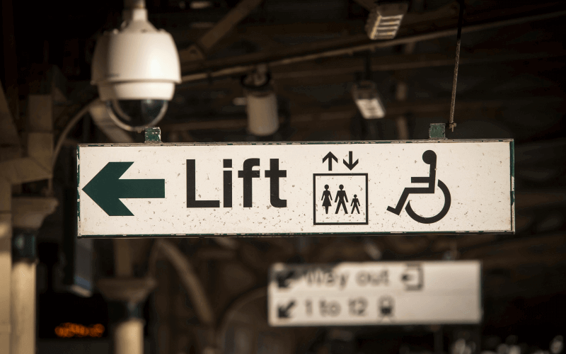A sign showing access at a rail station