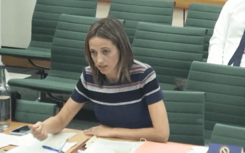 Helen Whately giving evidence at a desk