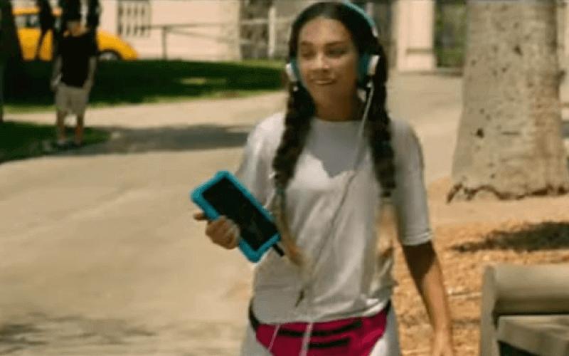 Maddie Ziegler in the film, wearing headphones