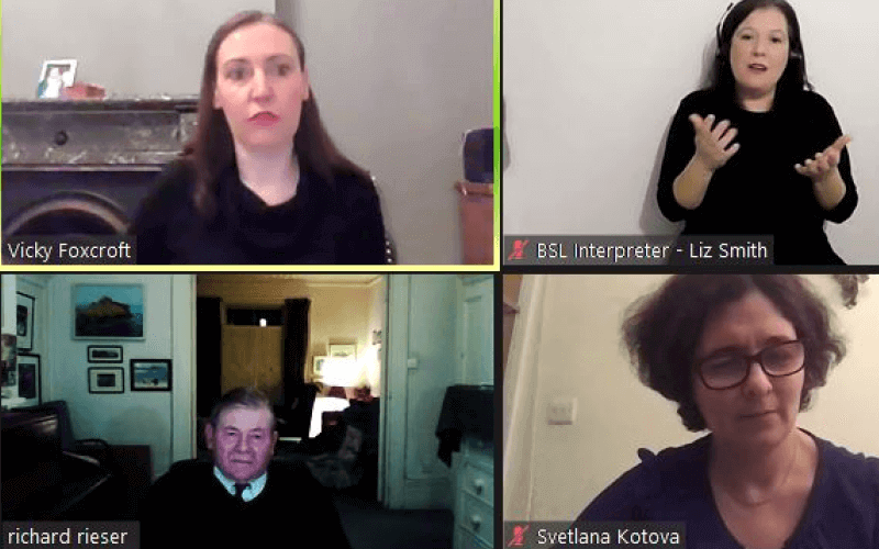 Screen shot of four people in their own homes at a Zoom meeting
