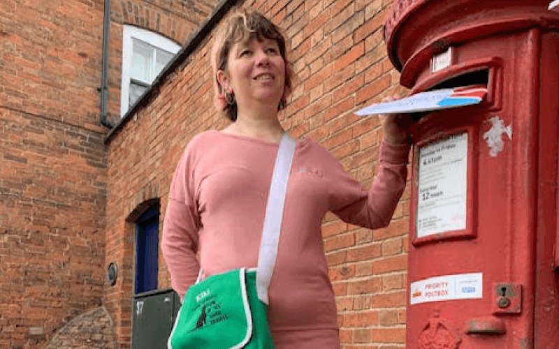 Sarah Leadbetter at a postbox