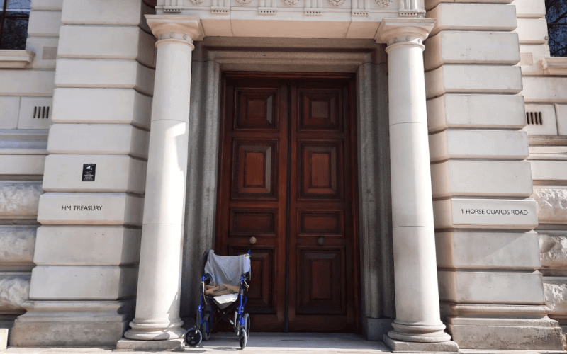 An empty wheelchair on the doorstep of the Treasury