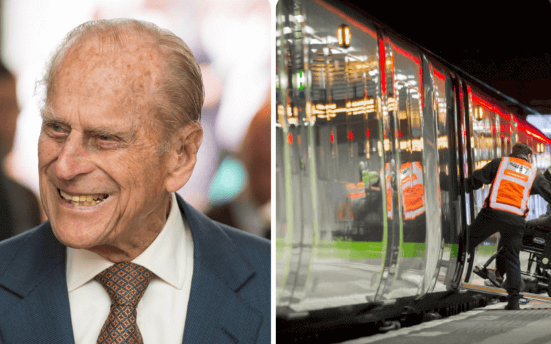 Head and shoulders of Prince Philip and a wheelchair-user boarding a train
