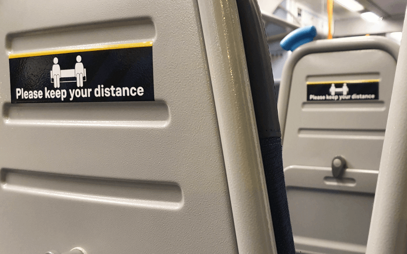 social distacing sign on the back of a seat