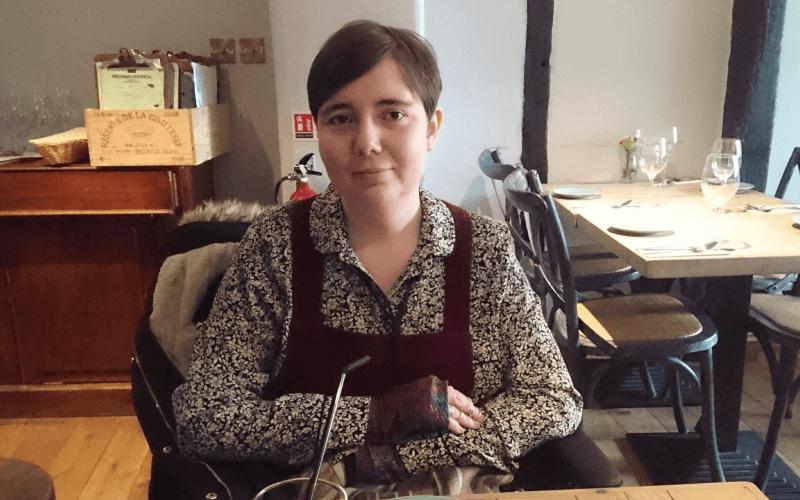 Helen Jones in her wheelchair in a cafe