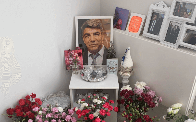 Picture of Saber Neda surrounded by flowers and other pictures