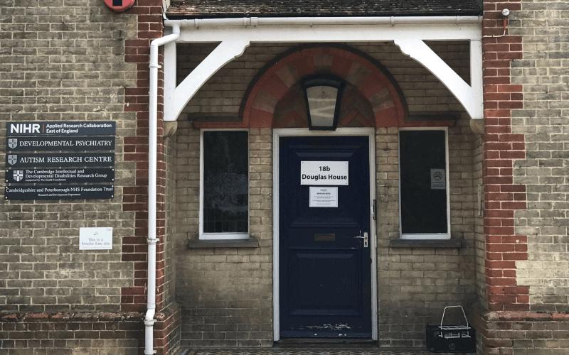 A black door of a brick house
