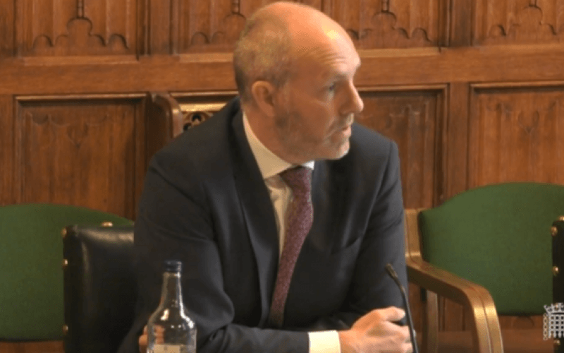 Justin Tomlinson speaking to the work and pensions committee